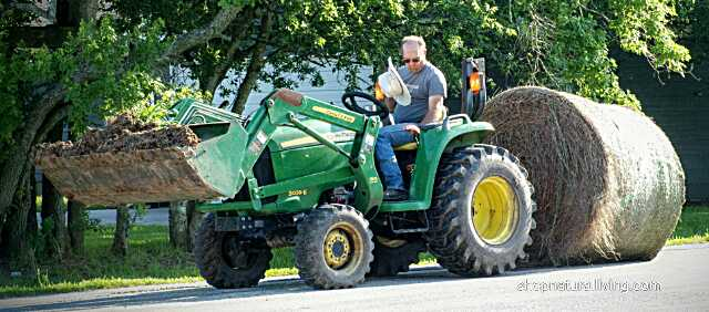 Picture of local farmer riding farm tractor