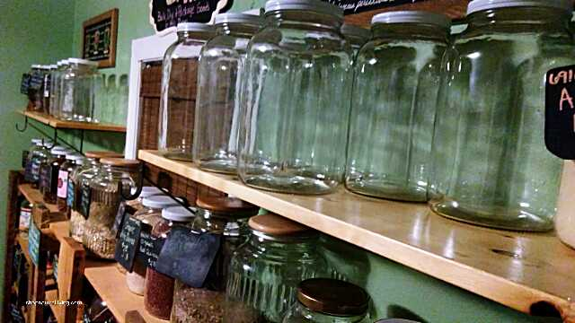 Picture new glass storage jars and shelves for organic bulk dry goods